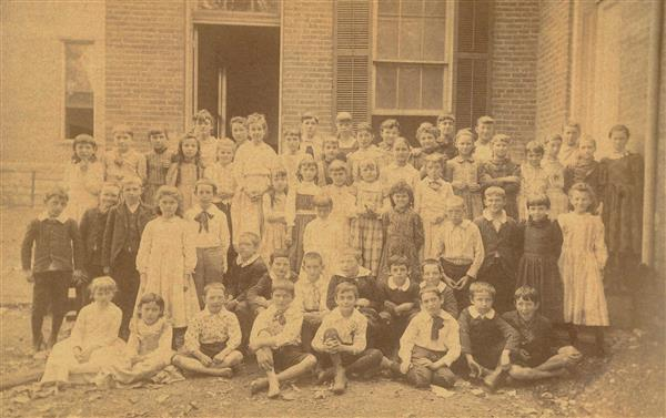 Photo: Mrs. Wallace's 1st grade class at Peabody, 1887. From LRSD archives.