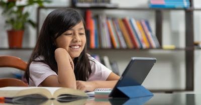 Girl sitting in front of computer