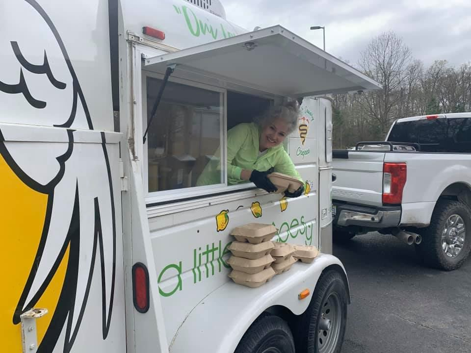 Photo of volunteer with food in her food truck